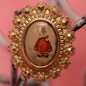A Vintage Gold Tone Pin